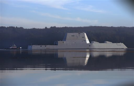 The first Zumwalt-class destroyer, USS Zumwalt, the largest ever built for the U.S. Navy, glides down the Kennebec River, Monday, Dec. 7, 2015, in Bath, Maine. The ship is headed out to sea for the first time to undergo sea trials.(AP Photo/Robert F. Bukaty)