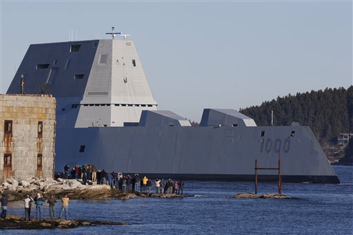 The first Zumwalt-class destroyer, USS Zumwalt, the largest ever built for the U.S. Navy, passes spectators at Fort Popham at the mouth of the Kennebec River in Phibbsburg, Maine, Monday, Dec. 7, 2015, in Bath, Maine. The ship is headed out to sea for the first time to undergo sea trials. (AP Photo/Robert F. Bukaty)