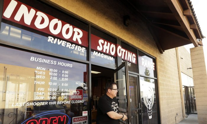 John Galletta, a firearms instructor at Riverside Magnum Range, opens a door at the range on Monday, Dec. 7, 2015, in Riverside, Calif. (AP Photo/Nick Ut)