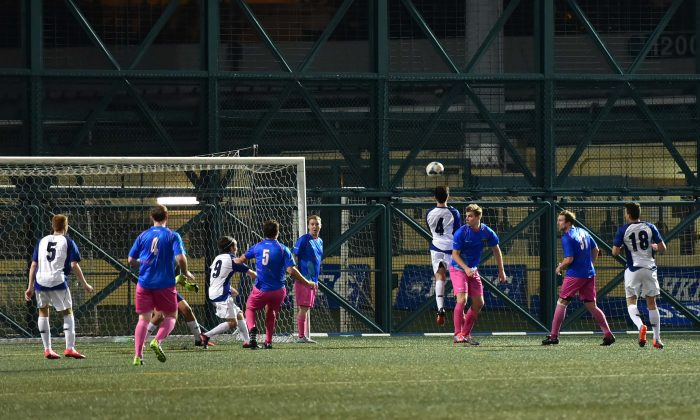 Goalmouth action in the match between Colts and HKDC Mobsters in the Yau Yee first Division, played at Sport Road on Sunday Dec 6. This entertaining all action game ended in a 4-4 draw. (Bill Cox/Epoch Times)
