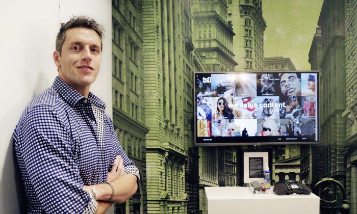 In this Wednesday, Nov. 4, 2015, photo, Sebastian Sobczak, CEO of Tsu.co, poses in his company's New York office. (AP Photo/Mark Lennihan)