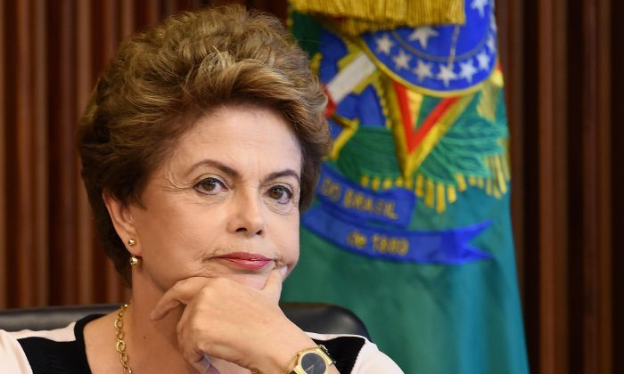 Brazilian President Dilma Rousseff at a meeting with a group of lawyers who claim that her impeachment lacks legal grounds, at the Planalto Palace in Brasilia, on Dec. 7, 2015. (Evaristo Sa/AFP/Getty Images)