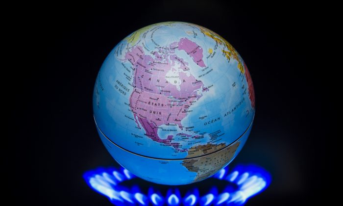 A small globe above a fire to illustrate global warming is seen during the 21st Session of the Conference of the Parties to the U.N. Framework Convention on Climate Change (COP21/CMP11), in France, on Nov. 4, 2015. (Lionel Bonaventure/AFP/Getty Images)