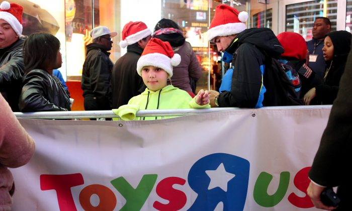 Customers wait in line to enter Toys R Us in Times Square on Thanksgiving evening for early Black Friday sales on November 26, 2015 in New York City (Yana Paskova/Getty Images)