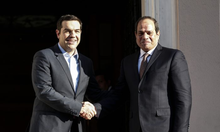 Greece's Prime Minister Alexis Tsipras (L) welcomes Egyptian President Abdel Fattah el-Sissi in Athens on Tuesday, Dec. 8, 2015. Egyptian President Abdel Fattah el-Sissi is in Athens for a two-day visit that will focus on energy and shipping, as financially troubled Greece seeks economic cooperation with regional partners. (AP Photo/Yorgos Karahalis)