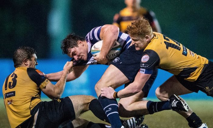 HKFC winger Charles Higson-Smith bundled up by Tigers ctrs Braam Gerber (l) and Sam Purvis in their HKRFU Premiership match at Kings Park on Saturday Dec 5, 2015. Borelli Walsh USRC Tigers won the match 24-18. (HKRFU)