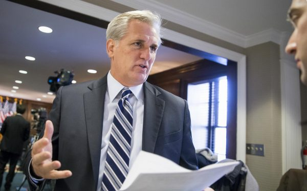 "Majority Leader Kevin McCarthy (R-Calif.) speaks with a reporter following a closed-door GOP caucus meeting at the Republican National Headquarters on Capitol Hill in Washington, D.C., Tuesday, Dec. 8, 2015. Invoking the Paris terror attacks, House lawmakers pushed toward a vote Tuesday on legislation tightening controls on travel to the U.S. and requiring visas for anyone who's been in Iraq or Syria in the previous five years. ""You have more than 5,000 individuals that have Western passports in this program that have gone to Iraq or Syria in the last five years,"" said McCarthy. ""Those are gaps that we need to fix."" (AP Photo/J. Scott Applewhite)"