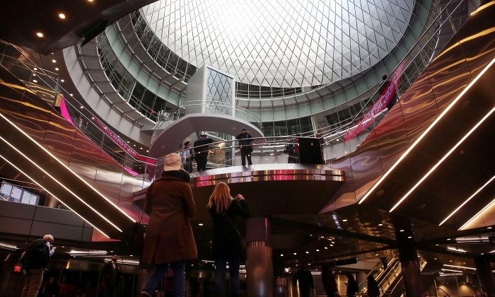Commuters walk through the newly opened Fulton Center train station in lower Manhattan on November 10, 2014 (Spencer Platt/Getty Images)