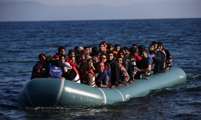 A migrant boat arrives after making the crossing from Turkey to the Greek island of Lesbos, in Sikaminias, Greece, on Nov. 12, 2015. Rafts and boats continue to make the journey from Turkey to Lesbos each day as thousands flee conflict in Iraq, Syria, Afghanistan, and other countries. Over 500,000 migrants have entered Europe so far this year and approximately four-fifths of those have paid to be smuggled by sea to Greece from Turkey, the main transit route into the EU. (Carl Court/Getty Images)