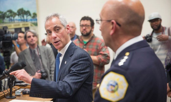 Interim Chicago Police Superintendant John Escalante (R) listens as Mayor Rahm Emanuel takes questions during a press conference in Chicago, Ill., on Dec. 7, 2015. (Scott Olson/Getty Images)
