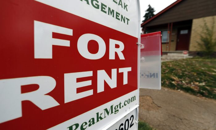 A rental sign is seen outside a property in Denver on Nov. 20, 2015. (AP Photo/David Zalubowski)