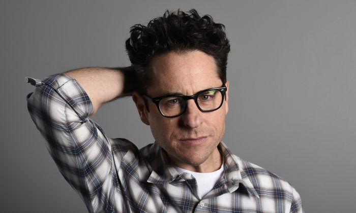 "This Sunday, Dec. 6, 2015 photo shows director/producer J.J. Abrams during a promotion for the new film, ""Star Wars: The Force Awakens"" in Los Angeles. The film opens in U.S. theaters on Dec. 18. (Photo by Jordan Strauss/Invision/AP)"