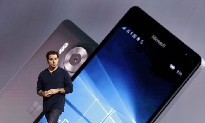 FILE - In this Tuesday, Oct. 6, 2015, file photo, Panos Panay, Microsoft vice president for Surface Computing, shows a new Lumia 950 phone during a presentation, in New York. (AP Photo/Richard Drew, File)