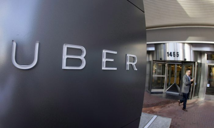 Uber announced Wednesday it will now offer full menus from more than 100 restaurants in the Toronto area, while still maintaining its short list of food items that can be delivered in under 10 minutes. (Eric Risberg/The Canadian Press via AP)