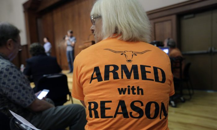 Professor Ann Cvetkovich waits to speak during a public forum at the University of Texas campus as a special committee studies how to implement a new law allowing students with concealed weapons permits to carry firearms into class and other campus buildings, Wednesday, Sept. 30, 2015, in Austin, Texas. The law takes effect in August 2016. (AP Photo/Eric Gay)