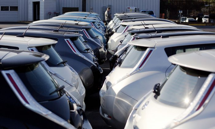 FILE - In this Feb. 5, 2015, file photo, Nissan electric vehicles sit on display at an auto dealership in Roswell, Ga. (AP Photo/David Goldman, File)