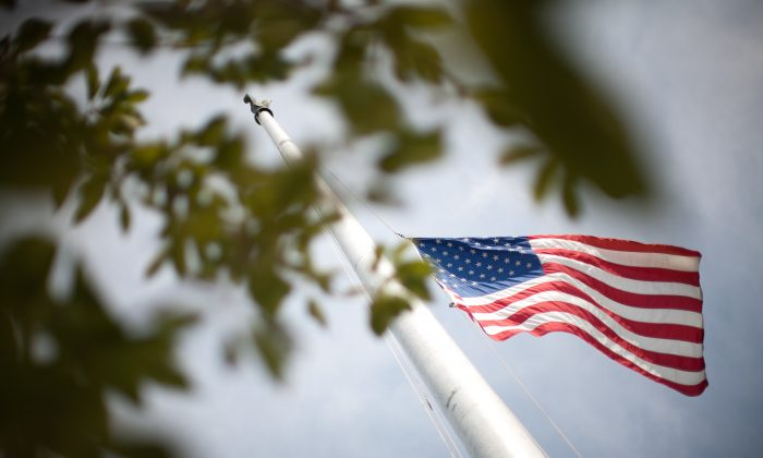 A flag flies at half staff outside the U.S. Supreme Court building in Washington, D.C., on June 28, 2010. (Brendan Hoffman/Getty Images)
