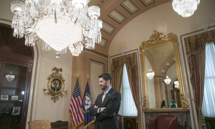 After rushing from a news conference, House Speaker Paul Ryan of Wis., waits in his ceremonial office on Capitol Hill in Washington, Thursday, Dec. 10, 2015,  for the arrival of Israeli President Reuven Rivlin. (AP Photo/J. Scott Applewhite)