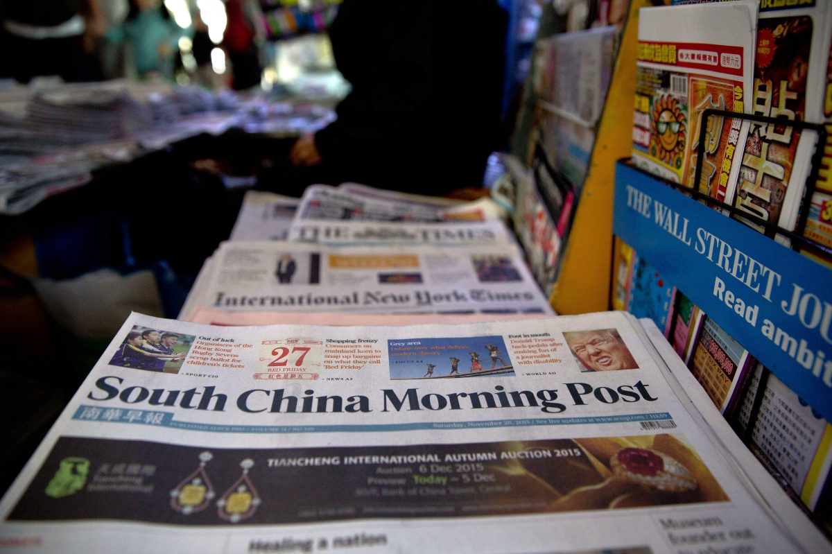 Copies of the South China Morning Post are displayed for sale at a newsstand in Hong Kong on Nov. 28, 2015. On Nov. 11, Jack Ma's Alibaba Group bought the 112-year-old publication and its media assets. (Dale de la Rey/AFP/Getty Images)
