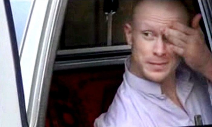 In this image made from video obtained from Voice Of Jihad Website, which has been authenticated based on its contents and other AP reporting, Sgt. Bowe Bergdahl, sits in a vehicle guarded by the Taliban in eastern Afghanistan. (Voice Of Jihad Website via AP video, File)
