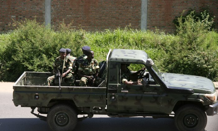 Military personnel sits aboard a vehicle driving through the Musaga neighbourhood of the city of Bujumbura, Burundi, on Dec. 11, 2015. (Stringer/AFP/Getty Images)