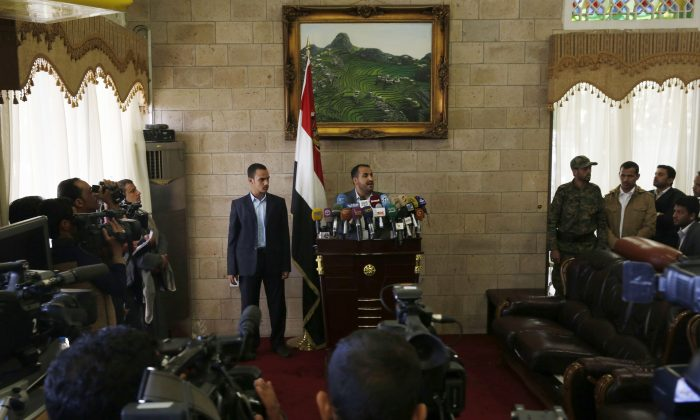 The spokesman of the Shiite rebels known as Houthis, Mohammed Abdel Salam (C), speaks at a press conference prior to the departure of the Houthi delegation for the Geneva peace talks, in Sanaa, Yemen, Saturday, Dec. 12, 2015. The fighting in Yemen pits the Houthis and troops loyal to former President Ali Abdullah Saleh against southern separatists, local and tribal militias, Sunni Islamic militants and President Hadi's loyalists. (AP Photo/Hani Mohammed)
