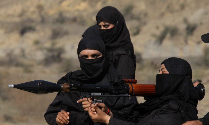 Pakistani female police commandos attend a training session in Nowshera, near Peshawar Pakistan, on Feb. 11, 2015. Authorities formed a Special Combat Unit after Taliban militants stormed a Peshawar school on Dec. 16, 2014 and massacred 150 children and teachers. (AP Photo/Mohammad Sajjad)
