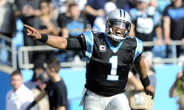 Cam Newton threw for 265 yards and 3 TDs in the 38–0 win, in a file photo. (Mike McCarn/AP Photo)