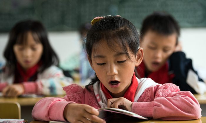 A Chinese schoolgirl attends class in China's Hunan Province on Oct. 8, 2015.  (Johannes Eisele/AFP/Getty Images)