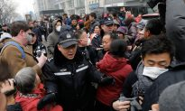 Lawyer on Trial in Beijing as Police Scuffle With Protesters