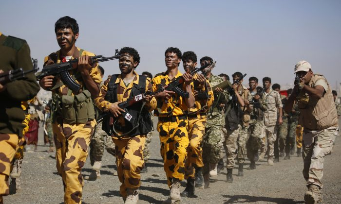 Shiite fighters, known as Houthis, parade during a tribal gathering showing support for the Houthi movement in Sanaa, Yemen, Monday, Dec. 14, 2015. (AP Photo/Hani Mohammed)