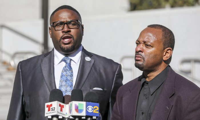 Najee Ali, right, and Rev. K.W. Tulloss speak to reporters in front of the Hall of Justice building during a news conference about Saturday's fatal shooting of a man by Los Angeles County Sheriff's deputies in Lynwood, Sunday, Dec. 13, 2015, in Los Angeles. (AP Photo/Ringo H.W. Chiu)