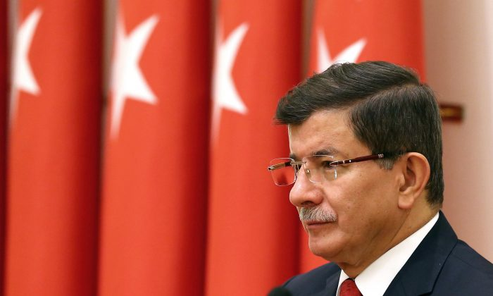 Turkish Prime Minister Ahmet Davutoglu attends an annual meeting of High Military Council  in Ankara, Turkey, Thursday, Nov. 26, 2015. (AP Photo/Prime Minister's Press Service)