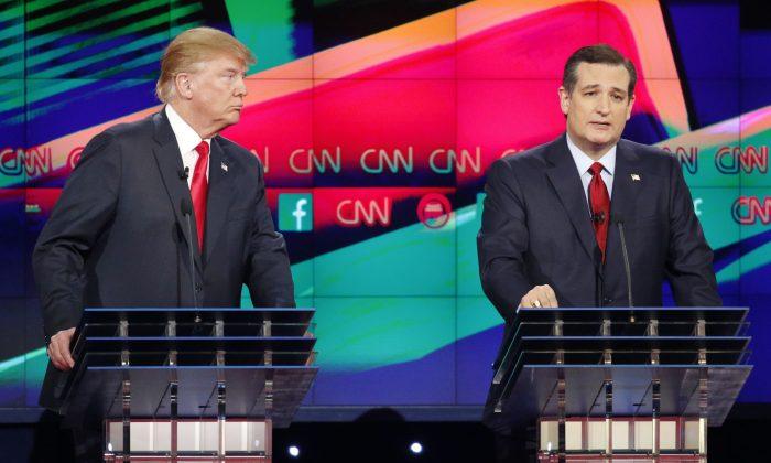 Ted Cruz, right, speaks as Donald Trump looks on during the CNN Republican presidential debate at the Venetian Hotel & Casino on Tuesday, Dec. 15, 2015, in Las Vegas. (AP Photo/John Locher)