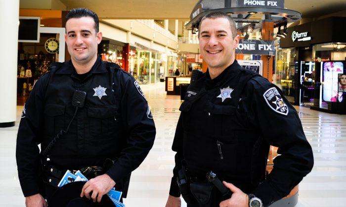 (L-R) Orange County Deputy Sheriffs Ferrantelli and Weibolt at Galleria Mall in Wallkill on Dec. 11, 2015. (Yvonne Marcotte/Epoch Times)