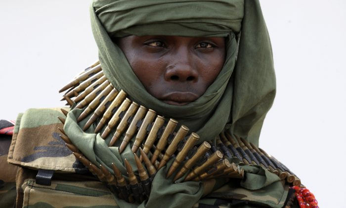 A Seleka rebel carries cartridge belts around his neck in Bangui on March 29, 2013. (Sia Kambou/AFP/Getty Images)
