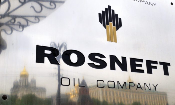 The Kremlin is reflected in a polished plate of the state-controlled Russian oil giant Rosneft at the entrance of its headquarters in Moscow, on May 17, 2011. (Dmitry Kostyukov/AFP/Getty Images)