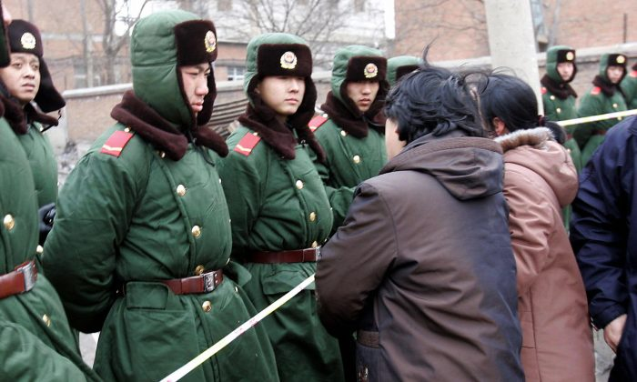 Chinese paramilitary policemen guard an accident site in northeastern China in February 2005. (AFP/Getty Images)