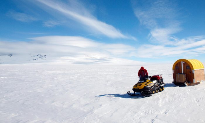 Andrew Lloyd snowmobiled more than 1,000 miles, living in a Scott tent, to recover the data. (Credit: Mike Roberts)