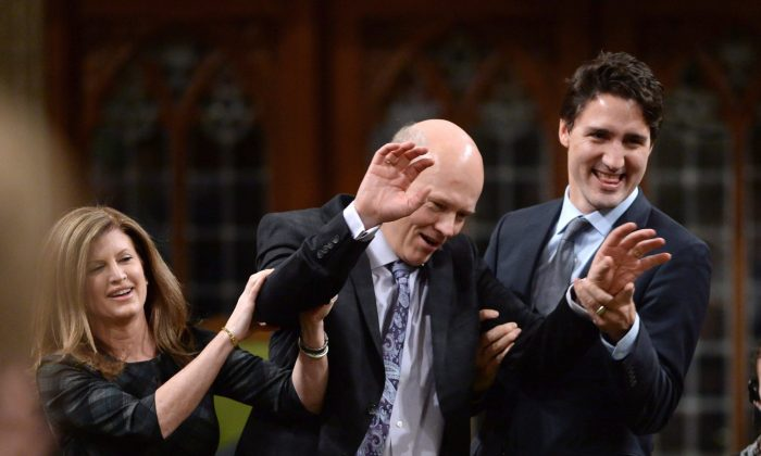 Newly elected Speaker of the House Geoff Regan jokingly resists as he's escorted to the speaker's chair by Conservative interim leader Rona Ambrose and Prime Minister Justin Trudeau in the House of Commons on Dec. 3. (THE CANADIAN PRESS/Sean Kilpatric)