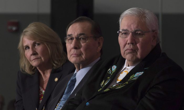 (L-R) Commissioner Marie Wilson, Commissioner Chief Wilton Littlechild, and Commissioner Justice Murray Sinclair listen to a speaker as the final report of the Truth and Reconciliation commission is released on December 15 in Ottawa. (THE CANADIAN PRESS/Adrian Wyld)