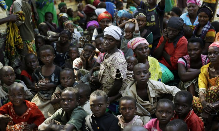 Refugees who fled Burundi's violence and political tension wait to board a U.N. ship at Kagunga on Lake Tanganyika, Tanzania, on May 23, 2015, to be taken to the port city of Kigoma. (AP Photo/Jerome Delay)