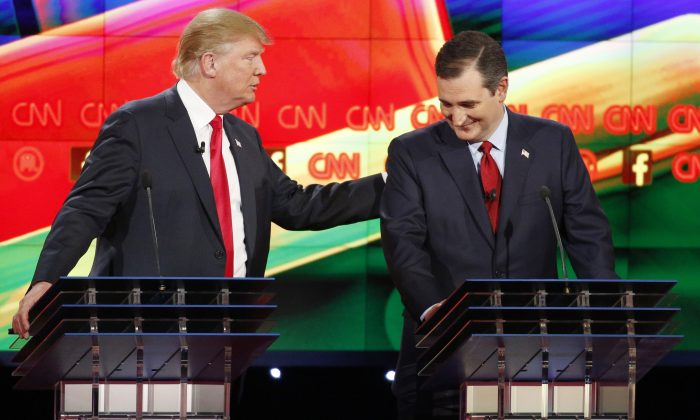 Donald Trump, left, and Ted Cruz joke about remarks Cruz has made about Trump's temperament during the CNN Republican presidential debate at the Venetian Hotel & Casino on Tuesday, Dec. 15, 2015, in Las Vegas. (AP Photo/John Locher)