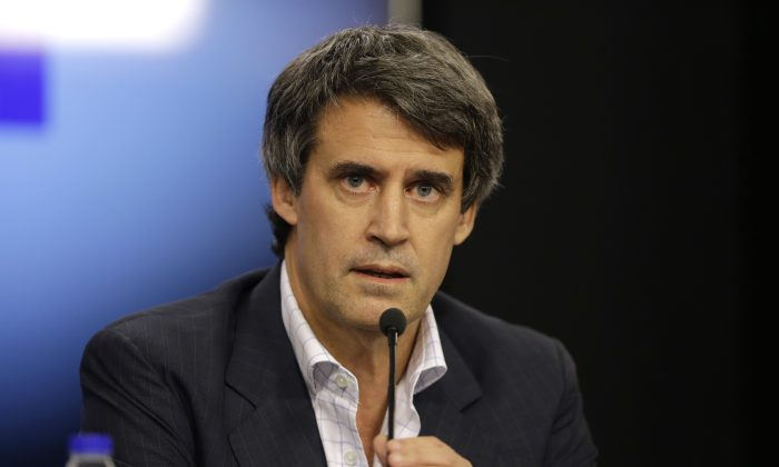 Argentina's Finance Minister Alfonso Prat-Gay in Buenos Aires, Argentina, on Dec. 16, 2015. The Argentine government has announced plans to lift deeply unpopular restrictions on buying U.S. dollars that have created a booming black market in the South American nation. (AP Photo/Victor R. Caivano)