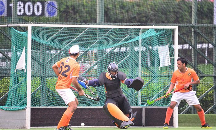 Unstoppable: SSSC-A keeper Gurdev Singh, who was voted 'Man of the Match' watches in vain as Khalsa-A's player/coach buries his penalty corner to hand Khalsa-A a 2-1 victory in the Guru Nanak Cup final, at Happy Valley on Sunday Dec 13, 2015. (Eddie So)