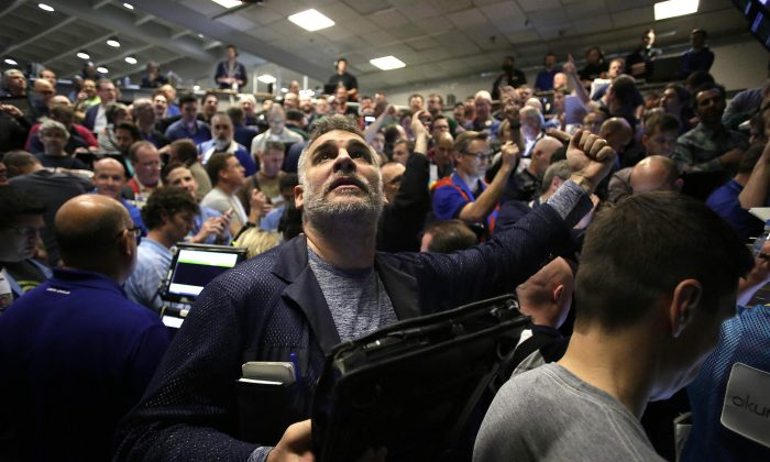 Traders in the Standard & Poor's 500 stock index options pit at the Chicago Board Options Exchange (CBOE) react after it was announced that they Federal Reserve would increase interest rates, in Chicago, Ill., on Dec. 16, 2015. The Federal Reserves raised the interest rates for the first time since 2006 by 0.25 percentage points. (Joshua Lott/Getty Images)