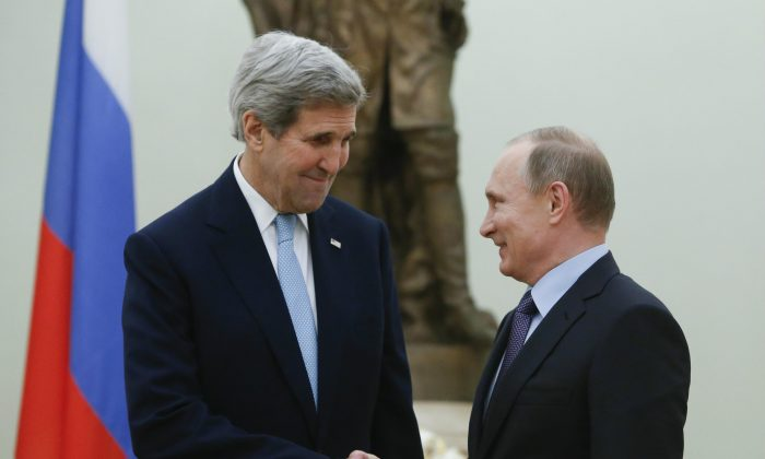 Russian President Vladimir Putin (R) and U.S. Secretary of State John Kerry at a meeting in the Kremlin in Moscow, Russia, on Dec. 15, 2015. The United States and Russia need to find common ground to end Syria's civil war and restore stability in eastern Ukraine, Kerry said Tuesday, as he met with President Putin to try to narrow gaps in the countries' approaches to the crises. (Sergei Karpukhin/AP)