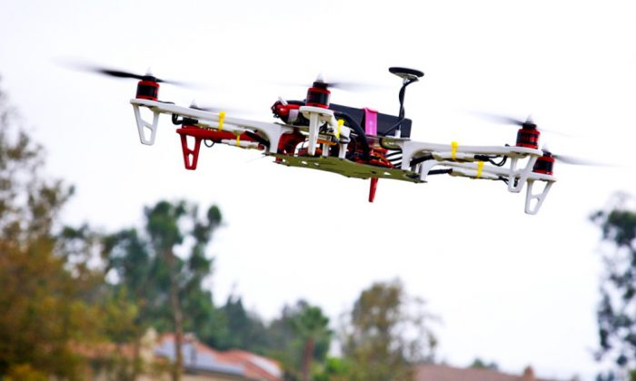 Engineers are developing software to predict and prevent collisions of unpiloted aircraft so that, within  milliseconds, a dozen drones delivering Christmas Eve packages will know precisely what maneuvers to take to ensure each enjoys a safe flight path down a crowded cul-de-sac. (Richard Unten/CC BY 2.0)