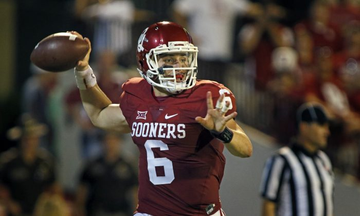 Quarterback Baker Mayfield has the Oklahoma Sooners in the playoffs and in the running for the first national title since 2000. (Brett Deering/Getty Images)