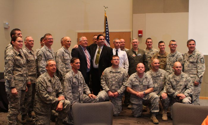 Walter O'Brien, CEO of Scorpion Security, stands for a photo with several military colonels during a meeting at the Northeast Indiana Defense Industry Association Mega Conference in October. O'Brien has been trying to help the Pentagon and U.S. government improve their cybersecurity. (Randy Jackson)